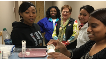 A group of women doing training to be a certified nursing assistant
